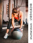 Small photo of Strong single-minded woman in the gym - a slim athletic figure