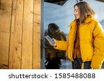 Woman Locking Smartlock On The...