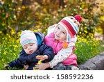 pretty girl hugging baby... | Shutterstock . vector #158592236