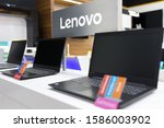Small photo of Belgrade, Serbia - December 05, 2019: New Lenovo laptop computers are shown on retail display in electronic store. Brand logo in the background.