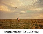 dad with daughter launch a kite. | Shutterstock . vector #158615702
