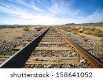 Steel Railroad Tracks Lead Int...