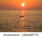 Fishermen In Boat At Sea With...