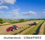 Aerial View Of Tractors Baling...