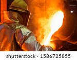 Worker In Protective Clothing...