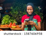Young African Woman Selling In...