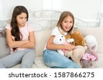 Small photo of Kids play toys in bed. Little girls spend time together. Friendship sisterhood personal relations. Toys shop. Cute soft toys. Generosity and greediness. Teach sister sharing toys. Greedy sisters.