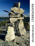 Cairn or stone man or inukshuk at the Hidden Lakes, Ingraham Trail, Northwest Territories, Canada