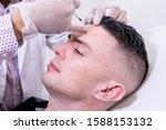 Caucasian Man Undergoing Beaut...