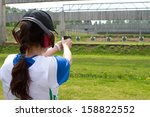 woman shooting in shooting range | Shutterstock . vector #158822552