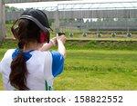 Woman Shooting In Shooting Range