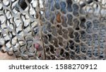 Small photo of Rat in cage mousetrap on white background, Mouse finding a way out of being confined, Trapping and removal of rodents that cause dirt and may be carriers of disease, Mice try to find freedom