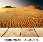sunset and empty wooden desk... | Shutterstock . vector #158850476