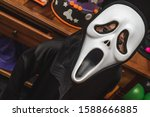 A Boy Wearing A Halloween Mask...