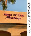 Small photo of YORBA LINDA, CA, UNITED STATES/ December 13, 2019: Home of the Mustangs sign at Yorba Linda High School in the front of the gym.