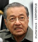Small photo of KUALA LUMPUR, MALAYSIA: MARCH 14, 2009 - (FAIL PIC) Spontaneous reaction of the ninth Prime Minister of Malaysia, Dr. Mahathir Mohamad while on vacation after speaking at a vacana held in Kuala Lumpur