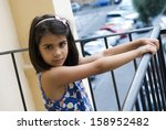 on the balcony of home. portrait | Shutterstock . vector #158952482