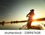 young man fishing from a boat... | Shutterstock . vector #158967638