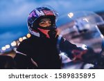 Woman On Motorbike In The City...