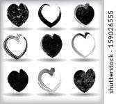 set of black grunge hearts  | Shutterstock .eps vector #159026555