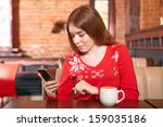 beautiful girl picking up sms... | Shutterstock . vector #159035186