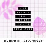 embossed letters tape font.... | Shutterstock .eps vector #1590780115