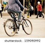 Man on bike in traffic - stock photo