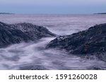 Waves Hitting Rocks With Long...