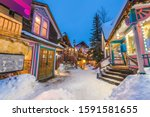 Breckenridge, Colorado, USA downtown streets at night in the winter with holiday lighting.