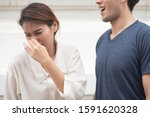 Small photo of woman suffering from man bad breath, concept of tooth decay, gingivitis, poor oral hygiene, bad breath or ordor smell from unhealthy mouth, poor personality, oral hygiene health care