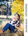 smiling girl outside in... | Shutterstock . vector #159162962
