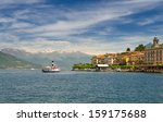Old steamboat ferry arriving at Bellagio with the Alps in the background, Lake Como, Northern Italy - stock photo