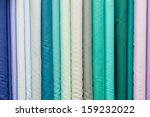 rolls of colorful fabric as a...