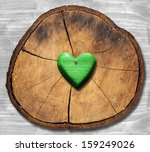 Green Heart On Section Of Tree...