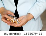 pills in female hands  woman in ... | Shutterstock . vector #1593079438