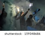 soccer fans with fireworks | Shutterstock . vector #159348686