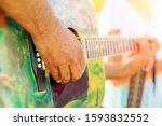 Street Musician Playing Guitar...
