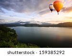 hot air balloons floating over... | Shutterstock . vector #159385292