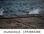 A Sea Wave Hits The Pier From...