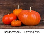 Four Orange Autumn Pumpkins On...