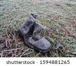 A Black Boot Is Thrown Into The ...