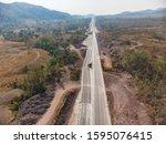 aerial shot of road... | Shutterstock . vector #1595076415