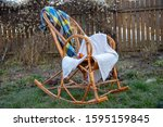 A Wicker Rocking Chair With...