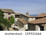 Village of Lacoste in the Luberon, France. This village was in the past the homecity of the Marquis de Sade. Fashion designer Pierre Cardin owns and  has restored the old castle  - stock photo