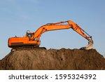 excavator on a heap of gravel.... | Shutterstock . vector #1595324392