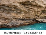 Small photo of Strata of Mudrocks, it is a silicicastic sedimentary rock include siltstone, claystone, mudstone, slate & shale formed by accumulated sedimentation then uplifted in folded mountains of Himalayas.