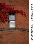 Red Brick Building With Ivy...