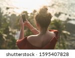 young girl takes pictures of... | Shutterstock . vector #1595407828