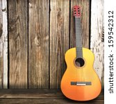Acoustic Wooden Guitar Leaning...