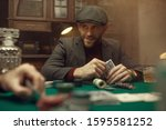 Professional poker player feels the risk, casino - stock photo
